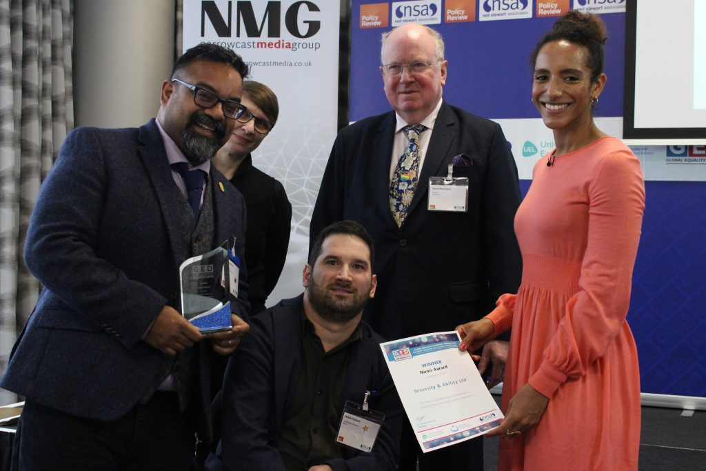 Chief Executive Atif Choudhury and Adam Hyland, Director of Campaigns at Diversity and Ability Ltd receive the 2018 Noon Award.